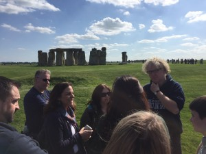 JAS member Prof David Jacques explains the wonders of Stonehenge to colleagues